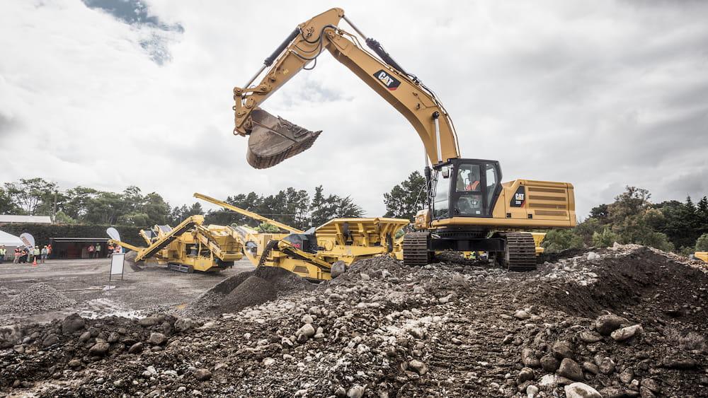 Excavator vs Wheel Loader in a quarry feeding crushing and screening equipment 16x9